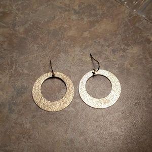 Golden earrings. Shimmering circles.